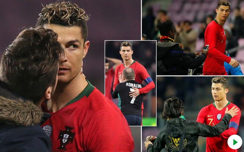 شاهد … مشجع يقتحم مباراة هولندا والبرتغال لتقبيل رونالدو